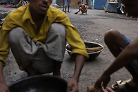 Artisanal gold smiths in Kolkata (Calcutta). These guys make about 3-400 USD a month at the top end.  They live in the workplace. Jewelry worker area early in the morning.  These guys sweep the streets at 1am thru the night when they are clear of people. They then pan for gold in the early hours.