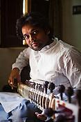 34 year old Sitar player, Deobrat Mishra poses for a portrait in his house in Varanasi, Uttar Pradesh, India. Photograph: Sanjit Das/Panos