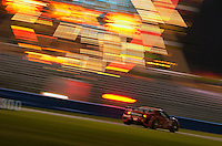 Rolex 24 at Daytona, Daytona International Speedway 5/6 Feb, 2005.The #52 MasterCar Ferrari 360 races through the infield Sunday morning..Copyright©F.Peirce Williams 2005