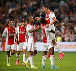 Nederland, Amsterdam, 15 augustus 2015<br /> Eredivisie<br /> Seizoen 2015-2016<br /> Ajax-Willem ll (3-0)<br /> Anwar El Ghazi van Ajax viert zijn doelpunt, de 2-0, met Kenny Tete (l.) en Riechedly Bazoer (m.) van Ajax.