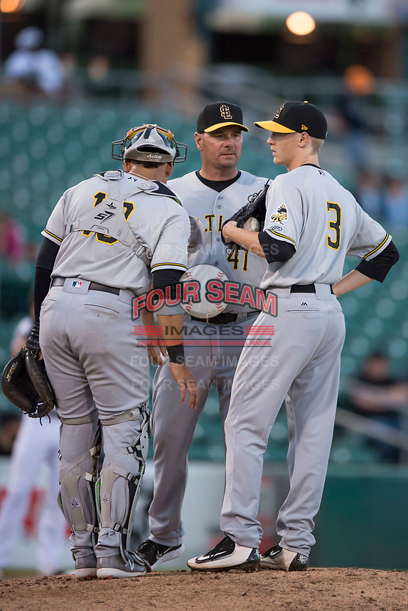 Salt Lake Bees pitching coach Erik Bennett (41) talks to Jose Briceno (10) and Simon Mathews (3) during a Pacific Coast League game against the Fresno Grizzlies at Chukchansi Park on May 14, 2018 in Fresno, California. Fresno defeated Salt Lake 4-3. (Zachary Lucy/Four Seam Images)