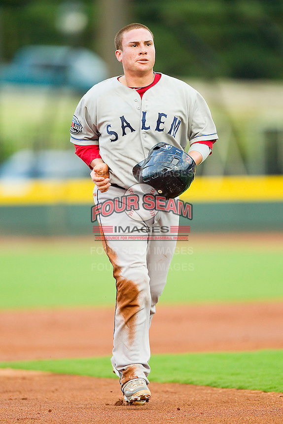 Christian Vazquez #12 of the Salem Red Sox jogs off the field between innings of the game against the Winston-Salem Dash at BB&T Ballpark on May 5, 2012 in Winston-Salem, North Carolina.  The Red Sox defeated the Dash 6-4.  (Brian Westerholt/Four Seam Images)
