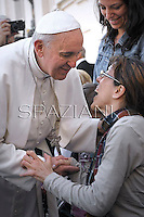 Pope Francis blesses disabled people after the Holy mass with the ecclesial movements for Pentecost Sunday on May 19, 2013