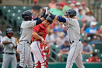 Columbus Clippers Erik Rodriguez (left) high fives Richie Shaffer (right) after hitting a two run home run during a game against the Rochester Red Wings on August 9, 2017 at Frontier Field in Rochester, New York.  Rochester defeated Columbus 12-3.  Catcher Anthony Recker is in the background.  (Mike Janes/Four Seam Images)