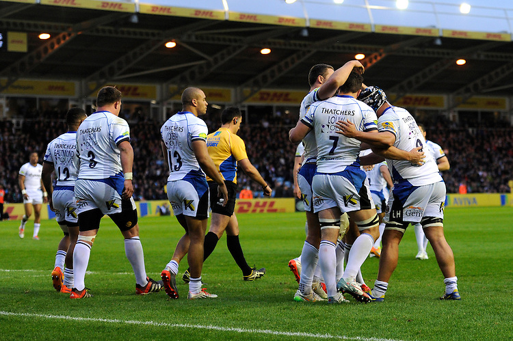 Francois Louw of Bath Rugby is congratulated by team mates after scoring a try