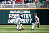 Michigan Wolverines outfielders Jesse Franklin (7), Christian Bullock (5) and Jordan Brewer (22) celebrated winning Game 1 of the NCAA College World Series against the Texas Tech Red Raiders on June 15, 2019 at TD Ameritrade Park in Omaha, Nebraska. Michigan defeated Texas Tech 5-3. (Andrew Woolley/Four Seam Images)