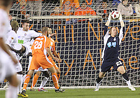 Eric Reed #23 Of the Carolina Railhawks grabs the ball from a header by Joshua Hansen #20 of the Puerto Rico Islanders during the second leg of the USSF-D2 championship match at WakeMed Soccer Park, in Cary, North Carolina on October 30 2010. The game ended 1-1, Puerto Rico won on overall goals 3-1.