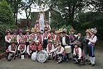 Uppermill,  Saddleworth, Yorkshire UK. Saddleworth Rushcart Morris men, outside The Commercial public house where the rushcart is made and kept.