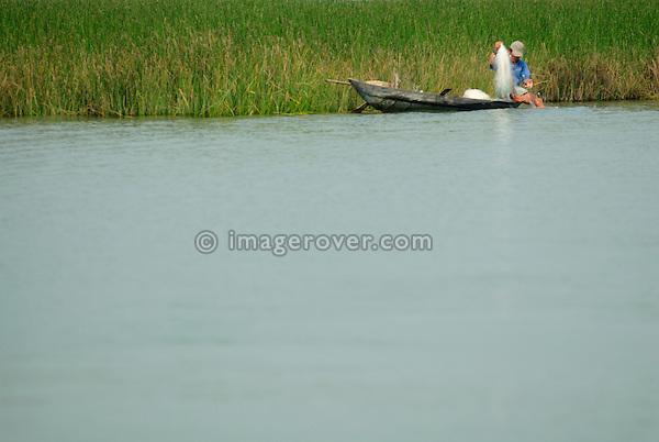 Asia, Vietnam, near Hoi An. Fisher on the Thu Bon river near Hoi An.