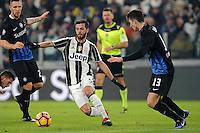 Calcio, Ottavi di finale di Tim Cup: Juventus vs Atalanta. Torino, Juventus Stadium, 11 gennaio 2017.<br /> Juventus' Miralem Pjanic, center, is challenged by Atalanta's Mattia Caldara, right, during the Italian Cup football round of 16 match between Juventus and Atalanta at Turin's Juventus Stadium, 8 January 2017. Juventus won 3-2 to join the quarter finals.<br /> UPDATE IMAGES PRESS/Manuela Viganti