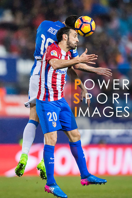 Juan Francisco Torres Belen, Juanfran, of Atletico de Madrid battles for the ball with Diego Rico of Deportivo Leganes during their La Liga match between Atletico de Madrid and Deportivo Leganes at the Vicente Calderón Stadium on 04 February 2017 in Madrid, Spain. Photo by Diego Gonzalez Souto / Power Sport Images