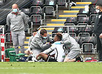 1st May 2021; Liberty Stadium, Swansea, Glamorgan, Wales; English Football League Championship Football, Swansea City versus Derby County; Jamal Lowe of Swansea City receives injury treatment during the first half