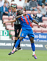 PARS ALEX KEDDIE AND CALEY'S GREGORY TADE GO FOR THE BALL