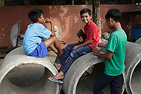 Battambang - Cambodia - June 2020<br /> - boys in   early morning near construction of sewer pipes