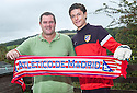 """Josuha Rae, who is 6' 1"""" despite only being  12 years old, and has been offered a deal with Atletico de Madrid after being invited for a trial after impressing one of their scouts while playing football on the beach on holiday in Benidorm. He is pictured with his dad Robert who accompanied him to Madrid."""