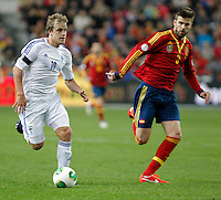 Spain's Gerard Pique and Finland's Pukki during international match of the qualifiers for the FIFA World Cup Brazil 2014.March 22,2013.(ALTERPHOTOS/Victor Blanco)