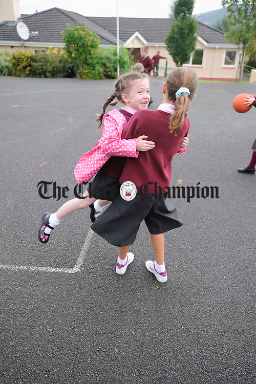 Rachel gives a swing to Finn at Ogonelloe NS. Photograph by John Kelly.