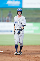 David Dahl (21) of the Asheville Tourists takes his lead off of second base against the Kannapolis Intimidators at CMC-NorthEast Stadium on July 13, 2014 in Kannapolis, North Carolina.  The Tourists defeated the Intimidators 8-2.  (Brian Westerholt/Four Seam Images)