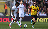 Luciano Narsingh of Swansea City is closely marked by Tom Cleverley of Watford during  the Premier League match between Watford and Swansea City at Vicarage Road Stadium, Watford, England, UK. Saturday 15 April 2017