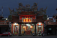 Temple illuminated at dusk in Taitung City, Taiwan. Taitung, and the coastal strip north of it up to Chenggong, has been seeing a big increase in property investment and new construction as people from the capital, Taipei, and some foreign investors, seek to buy holiday and retirement homes in this area of outstanding natural beauty. At the same time, property prices across the board in Taiwan are expected to rise bullishly following a return of the former ruling party - the KMT - to power in March 2008 elections, and their anticipated change of policy to allow Mainland Chinese purchases of Taiwan property..20 Jan 2008