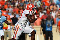 CHAPEL HILL, NC - SEPTEMBER 28: Travis Etienne #9 of Clemson University runs with the ball during a game between Clemson University and University of North Carolina at Kenan Memorial Stadium on September 28, 2019 in Chapel Hill, North Carolina.