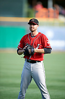 Albuquerque Isotopes starting pitcher Matt Flemer (24) warms up in the outfield before the game against the Salt Lake Bees in Pacific Coast League action at Smith's Ballpark on June 10, 2017 in Salt Lake City, Utah. The Isotopes defeated the Bees 4-2. (Stephen Smith/Four Seam Images)