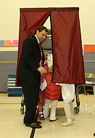 Tom Perriello, the Democratic nominee for US Representative from Virginia's 5th Congressional District, walks out of the voting booth with his nieces Tuesday Meriwether Lewis elementary school in Ivy, VA.(Photo/Andrew Shurtleff)