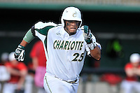 First baseman Logan Sherer (25) of the Charlotte 49ers runs out a ground ball in a game against the Fairfield Stags on Saturday, March 12, 2016, at Hayes Stadium in Charlotte, North Carolina. (Tom Priddy/Four Seam Images)