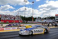 May 6, 2012; Commerce, GA, USA: NHRA pro stock driver Rodger Brogdon (near lane) races alongside Vincent Nobile during the Southern Nationals at Atlanta Dragway. Mandatory Credit: Mark J. Rebilas-