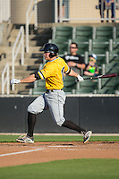 Chase Simpson (10) of the West Virginia Power follows through on his swing against the Kannapolis Intimidators at CMC-Northeast Stadium on April 21, 2015 in Kannapolis, North Carolina.  The Power defeated the Intimidators 5-3 in game one of a double-header.  (Brian Westerholt/Four Seam Images)