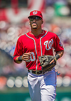 26 April 2014: Washington Nationals shortstop Ian Desmond returns to the dugout during a game against the San Diego Padres at Nationals Park in Washington, DC. The Nationals shut out the Padres 4-0 to take the third game of their 4-game series. Mandatory Credit: Ed Wolfstein Photo *** RAW (NEF) Image File Available ***