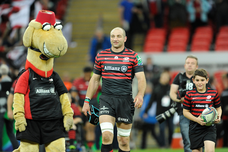 20131018 Copyright onEdition 2013©<br /> Free for editorial use image, please credit: onEdition<br /> <br /> Steve Borthwick of Saracens leads out the team with the mascot before the Heineken Cup match between Saracens and Stade Toulousain at Wembley Stadium on Friday 18th October 2013 (Photo by Rob Munro)<br /> <br /> For press contacts contact: Sam Feasey at brandRapport on M: +44 (0)7717 757114 E: SFeasey@brand-rapport.com<br /> <br /> If you require a higher resolution image or you have any other onEdition photographic enquiries, please contact onEdition on 0845 900 2 900 or email info@onEdition.com<br /> This image is copyright onEdition 2013©.<br /> This image has been supplied by onEdition and must be credited onEdition. The author is asserting his full Moral rights in relation to the publication of this image. Rights for onward transmission of any image or file is not granted or implied. Changing or deleting Copyright information is illegal as specified in the Copyright, Design and Patents Act 1988. If you are in any way unsure of your right to publish this image please contact onEdition on 0845 900 2 900 or email info@onEdition.com