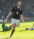 Dundee's Craig Beattie celebrates after he scores their third goal.