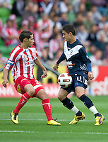 MELBOURNE, AUSTRALIA - DECEMBER 11: Aziz Behich of the Heart and Marvin Angulo of the Victory compete for the ball during the round 18 A-League match between the Melbourne Heart and Melbourne Victory at AAMI Park on December 11, 2010 in Melbourne, Australia. (Photo by Sydney Low / Asterisk Images)