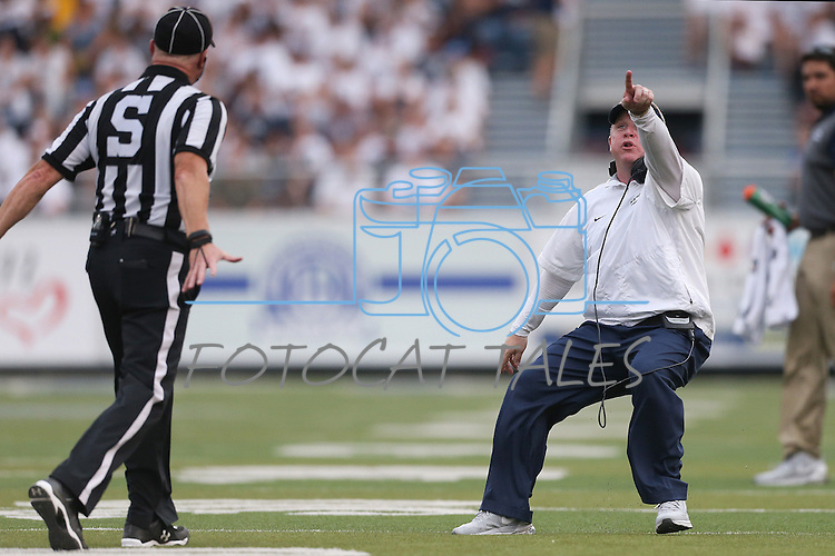 Nevada head coach Brian Polian argues with an official over the remaining time in a game against Arizona during the first half of an NCAA college football game in Reno, Nev. on Saturday, Sept. 12, 2015. (AP Photo/Cathleen Allison)