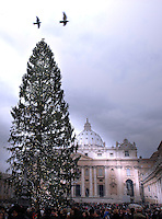 "Christmas tree during a ceremony ""Urbi et Orbi"" in St-Peter's square at the Vatican, 25 December 2008. Pope Benedict XVI waves to faithful during the ""Urbi et Orbi"" (to the City and to the World) message in St. Peter's square at the Vatican, Thursday, Dec. 25, 2008. The Pontiff in his Christmas message warned that the world was headed toward ruin if selfishness prevails over solidarity during tough economic times for both rich and poor nations. Speaking from the central balcony of St. Peter's Basilica on the day Christians commemorate Jesus' birth in Bethlehem, Benedict declared that the ""heart of the Christian message is meant for all men and women.."