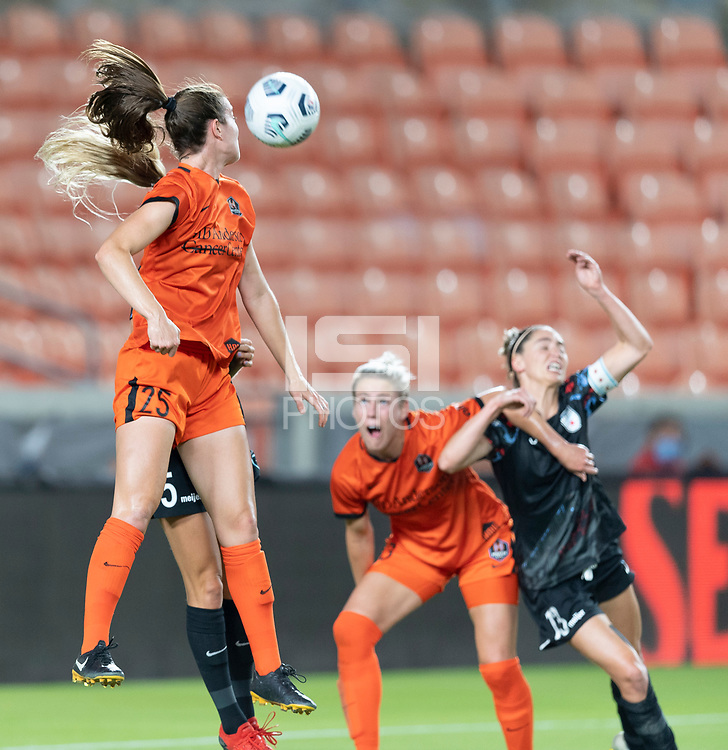 HOUSTON, TX - SEPTEMBER 10: Katie Naughton #25 of the Houston Dash heads the ball over Rachel Hill #5 of the Chicago Red Stars during a game between Chicago Red Stars and Houston Dash at BBVA Stadium on September 10, 2021 in Houston, Texas.