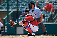 Rochester Red Wings catcher Cameron Rupp (22) waits to receive a pitch in front of home plate umpire Reid Gibbs during a game against the Lehigh Valley IronPigs on July 1, 2018 at Frontier Field in Rochester, New York.  Rochester defeated Lehigh Valley 7-6.  (Mike Janes/Four Seam Images)