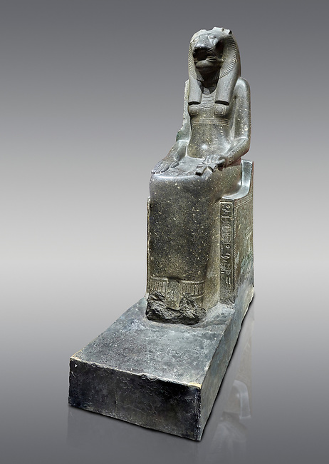 """Ancient Egyptian statue of goddess Sekhmet, grandodiorite, New Kingdom, 18th & 20thDynasty (1390-1150 BC), Thebes. Egyptian Museum, Turin. Grey Background.<br /> <br /> In this statue of Sekhmet the goddess is called """"mistress of Shenut"""" possibly linking her to the lioness goddess Repyt of Anthribis.  Sekhmet, """"the Powerful One"""" was a fearsome goddess symbolised by her lioness head. Daughter of the sun she personifies the disk of the world during the day. Sekhmet is the angry manifestation of Hathor inflicting the scourges of summer heat, famine and illness which is why the goddess needed to be exorcised every day. Drovetti Collection. C 248"""