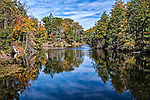 View of Pelton Pond, located in Fahnestock State Park in Cold Spring, New York, in autumn.