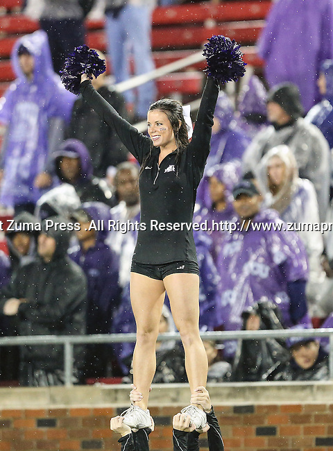 TCU Horned Frogs cheerleaders in action during heavy rainfall in the game between the Southern Methodist Mustangs and the TCU Horned Frogs at the Gerald J. Ford Stadium in Dallas, Texas. TCU defeats SMU 24 to 16..