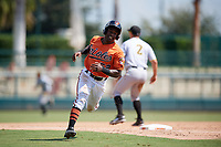 Baltimore Orioles Kirvin Moesquit (52) rounds third base to score a run during an Instructional League game against the Pittsburgh Pirates on September 27, 2017 at Ed Smith Stadium in Sarasota, Florida.  (Mike Janes/Four Seam Images)