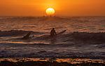171218 Surfers at sunrise Langland Bay