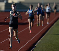 Emily Robinson (left) of Bentonville comes in at the finish Friday, April 30, 2021, to win the 1,600 meters during the 6A-West Conference Track and Field Meet at the Tiger Athletic Complex in Bentonville. Visit nwaonline.com/210501Daily/ for today's photo gallery. <br /> (NWA Democrat-Gazette/Andy Shupe)