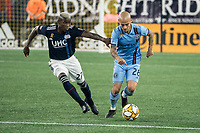 FOXBOROUGH, MA - SEPTEMBER 29: Luis Caicedo #27 of New England Revolution comes in to tackle Alexandru Mitrita #28 of New York City FC during a game between New York City FC and New England Revolution at Gillettes Stadium on September 29, 2019 in Foxborough, Massachusetts.