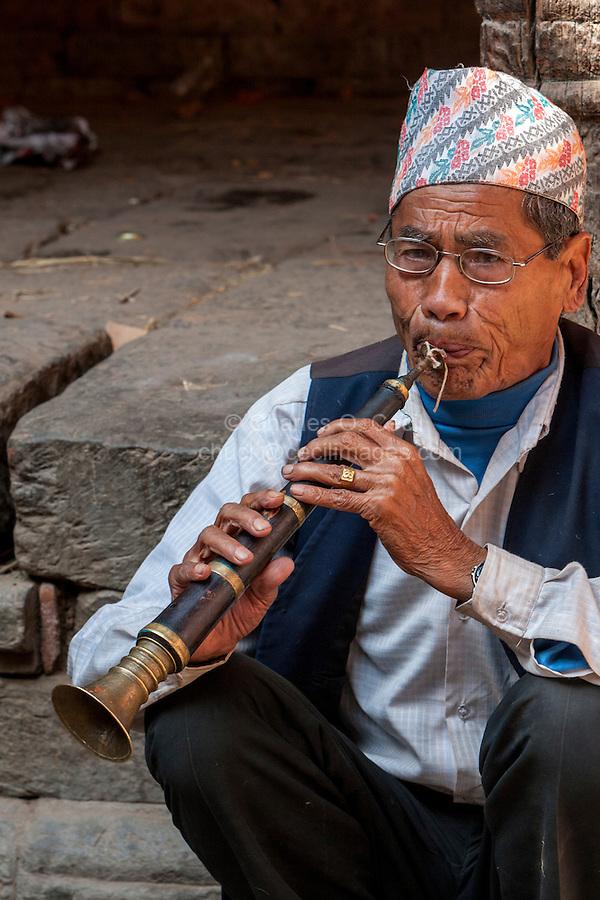 Bhaktapur, Nepal.  Newari Musician Playing Nepali Reed Instrument, Wearing Traditional Hat (Topi).