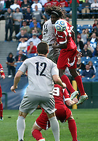 HOOVER, AL - DECEMBER 09, 2012: Femi Hollinger-Janzen (6) of Indiana University flicks the ball away from Cole Seiler (14) of Georgetown University during the NCAA 2012 Men's College Cup championship, at Regions Park, in Hoover , AL, on Sunday, December 09, 2012.