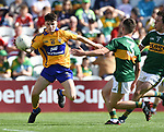 Thomas Kelly of Clare in action against Owen Fitgerald of Kerry during their Munster Minor football final at Pairc Ui Chaoimh. Photograph by John Kelly.