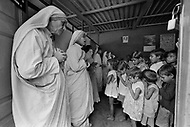 """Calcutta, India. April 04, 1975.<br /> Mother Teresa praying with children in the morning at her orphange. Mother Teresa (Agnes Gonxha Boyaxihu) the Roman Catholic, Albanian nun revered as India's """"Saint of the Slums,"""" was awarded the 1979 Nobel Peace Prize. Mother Teresa (Agnes Gonxha Boyaxihu) the Roman Catholic, Albanian nun revered as India's """"Saint of the Slums,"""" was awarded the 1979 Nobel Peace Prize."""