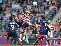 Glasgow, Scotland - Saturday, July 28, 2012: Abby Wambach of the USA Women's soccer team heads the ball towards goal during a 3-0 win over Colombia in the first round of the Olympic football tournament at Hamden Park.